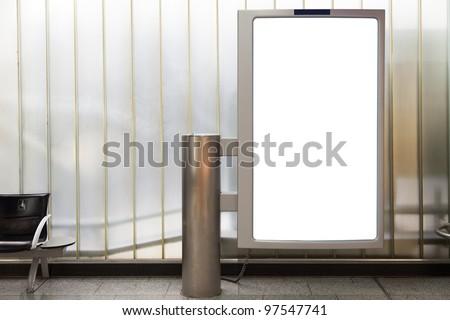 Blank vertical billboard located in underground hall