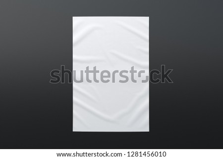 Blank vertical wrinkled street poster on black wall. With clipping path around poster. 3d illustration #1281456010