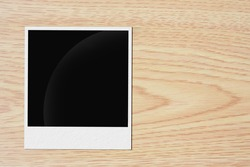 blank vintage paper and photo frame on wooden background