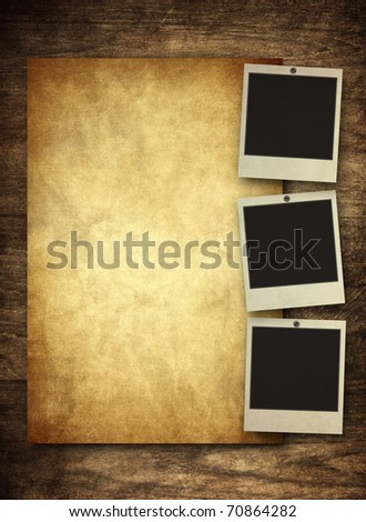 blank vintage paper and photo frame with space for your data on old wooden background