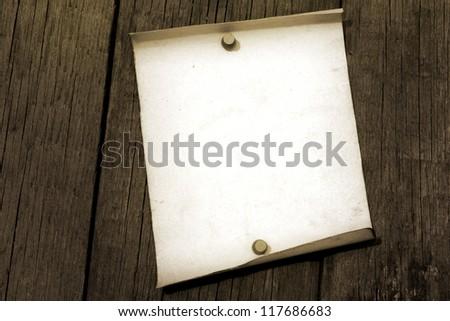 Blank vintage paper on old grunge wooden boards background