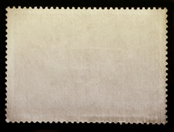 Blank vintage posted stamp isolated on black background.
