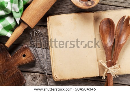 Blank vintage recipe cooking book and utensils. Top view with copy space