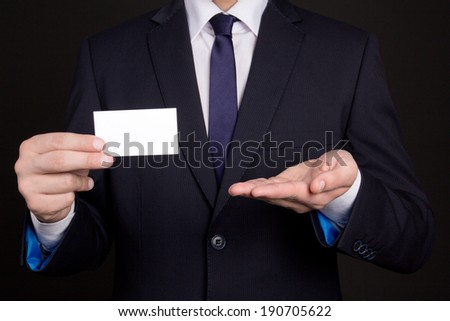 blank visiting card in young business man hand