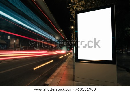 Blank white advertisement lightbox at night. Mock-up design concept. Car lights.