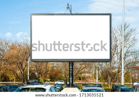 Blank white advertising display device on the car park Stockfoto ©