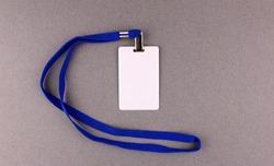 Blank white badge with blue drawstring on gray background. Pass to work, conference