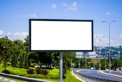 Blank white billboard against the blue sky