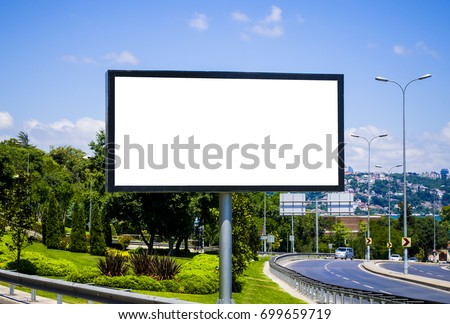 Blank white billboard against the blue sky
