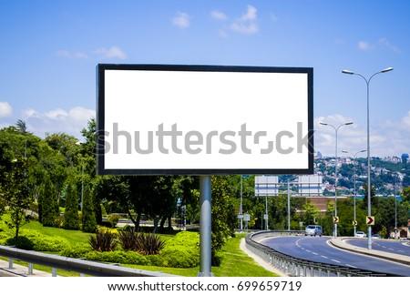 Blank white billboard against the blue sky - Shutterstock ID 699659719