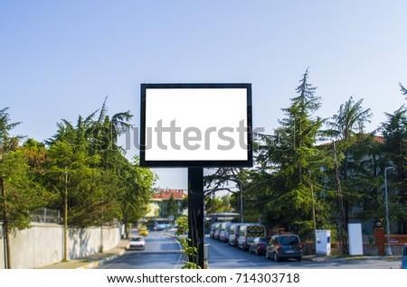 Blank white billboard against the blue sky - Shutterstock ID 714303718