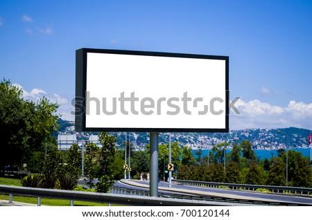 Blank White Billboard and Bosphorus River; Blue Sky - Shutterstock ID 700120144
