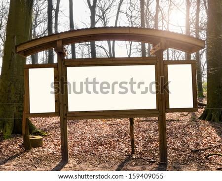 Blank white billboard in forest