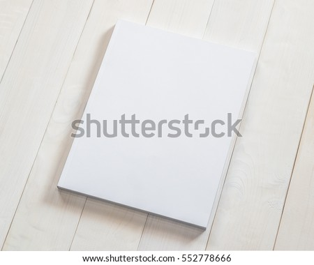 Blank white book cover template mockup with front page side placing on clean cream surface pine wood background: Empty paperback magazine catalog note book paper texture mock up on wood table backdrop