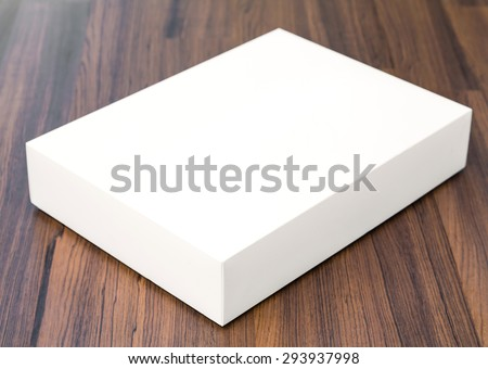 Blank white box mock up on wood background