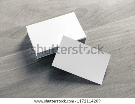 Blank white business cards on wood table background. Mockup for branding identity. #1172114209