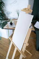 Blank white canvas on a wooden easel. Artist's Room