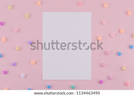 Blank white card decorate with pastel heart on pink background #1134463490