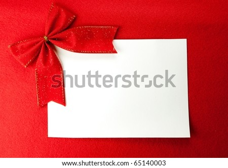 Blank white card on red Christmas background