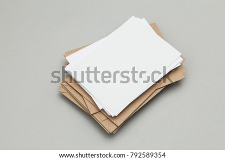 Blank white card with kraft brown paper envelope template mock up #792589354