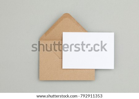 Blank white card with kraft brown paper envelope template mock up #792911353