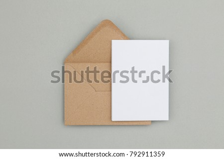 Blank white card with kraft brown paper envelope template mock up #792911359