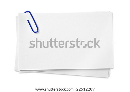 Blank white cards with blue paperclip, isolated on white background.  Clipping path included.