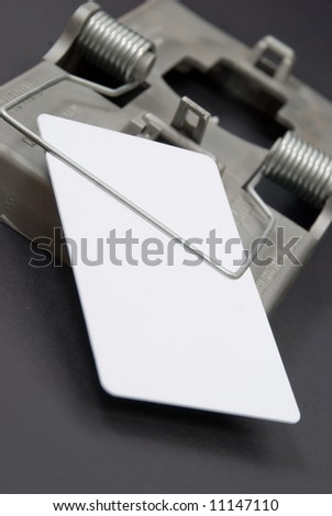 Blank white credit card caught in trap