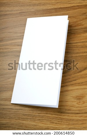blank white folding paper flyer on a wooden background, identity design, corporate templates, company style