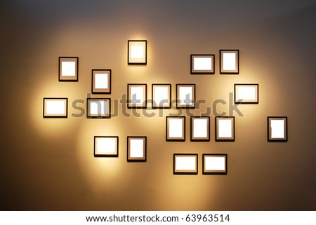 Blank white frames with a copy space area on a brown wall
