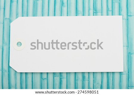 Blank White Gift Tag, White Blank Gift Tag with  copy-space for your message on a grunge wood background