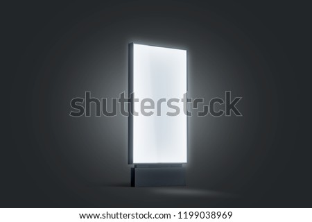 Blank white glowing pylon mockup, isolated in darkness, 3d rendering. Empty illumination street display mock up. Clear luminous outdoor lightbox template, side view. Advertising digital panel.