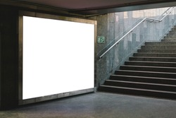 Blank white mock up billboard banner. Display in subway with stairs. Underground. Advertising. Ad. Horizontal. Transport