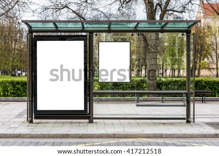 Blank white mock up of vertical billboard in a bus stop