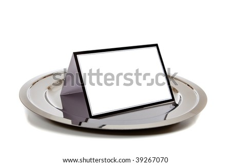 Blank white note-card lined in black on a silver tray on a white background