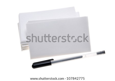 Blank white note cards with pen isolated on white