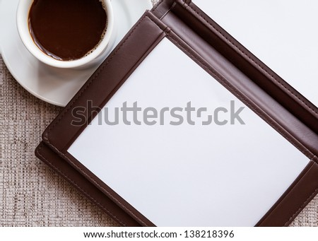 blank white notebook, and cup of coffee