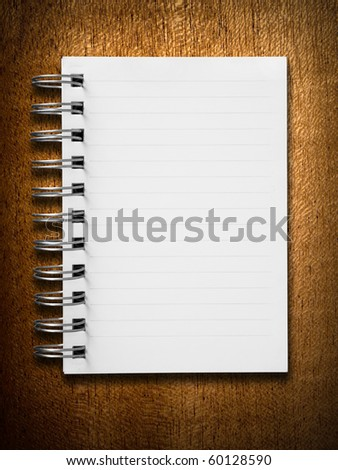 Blank white notebook on wood vertical background