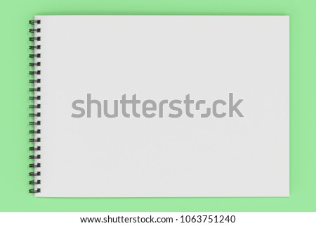 Blank white notebook with black spiral bound on green background. Business or education mockup. 3D rendering illustration