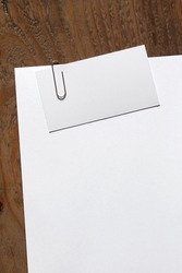 blank white paper and business card clipped a paperclip