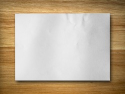 blank white paper on rubber wood background