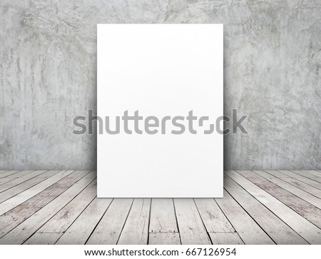 Blank  white paper poster leaning at concrete wall on wooden plank floor in perspective room,Business mock up presentation design.