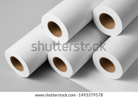 Blank white paper rolls isolated on gray background. Mockup paper for magazines, catalogs or newspapers isolated on gray backdrop, Printing house theme or wrapping paper for presents ストックフォト ©