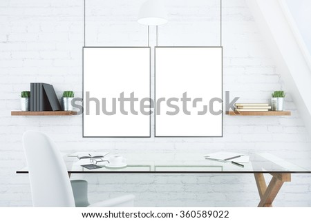 Blank white picture frames on brick wall in modern office with glassy table, mock up 3D Render
