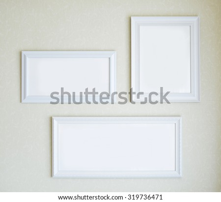 Blank White Picture Frames on the Wall