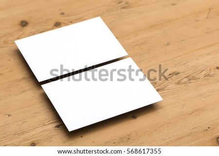 Blank white postcard on a wooden background #568617355