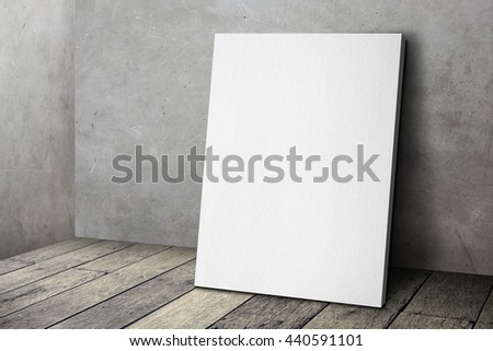 Blank white poster frame leaning at grunge grey concrete wall and wood floor, Mock up template for adding your design. #440591101