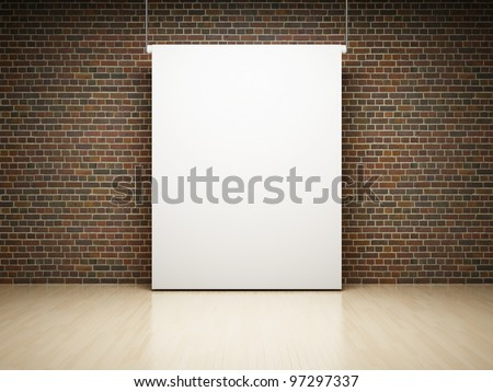 Blank white projection screen in studio on brick wall