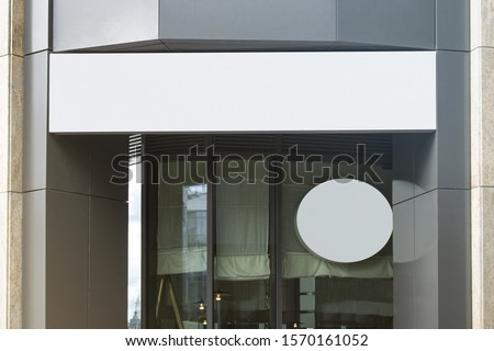 Blank white rectangular and round sign on business center mockup. Empty metal building with signplate panel mock up. Clear company or guesthouse lightbox shape mokcup template.