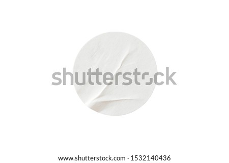 Photo of  Blank white round paper sticker label isolated on white background with clipping path